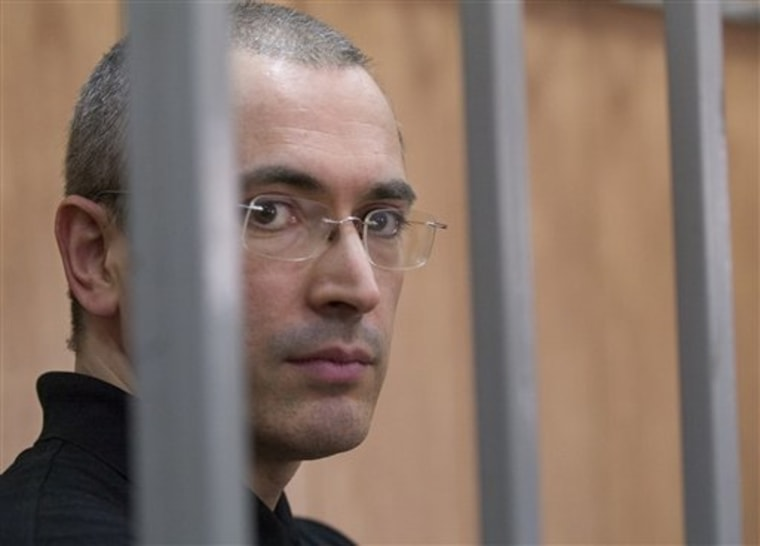 Former Yukos oil gaint chief Mikhail Khodorkovsky listens during a court session in Moscow Friday.