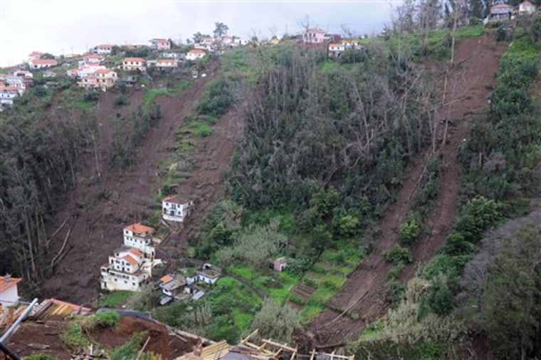 The scars left by landslides are seen Monday on the slopes of Curral das Freiras, a village in the interior of Madeira, Portugal.