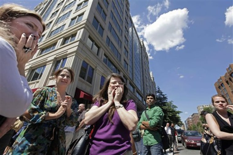 Office workers gather on the sidewalk in downtown Washington after a 5.9-magnitude earthquake on Aug. 23. The East Coast earthquake left more than just residents unaccustomed to feeling the ground shake in a daze. It also surprised scientists who spend their careers trying to untangle the mysteries of sudden ground shifts.