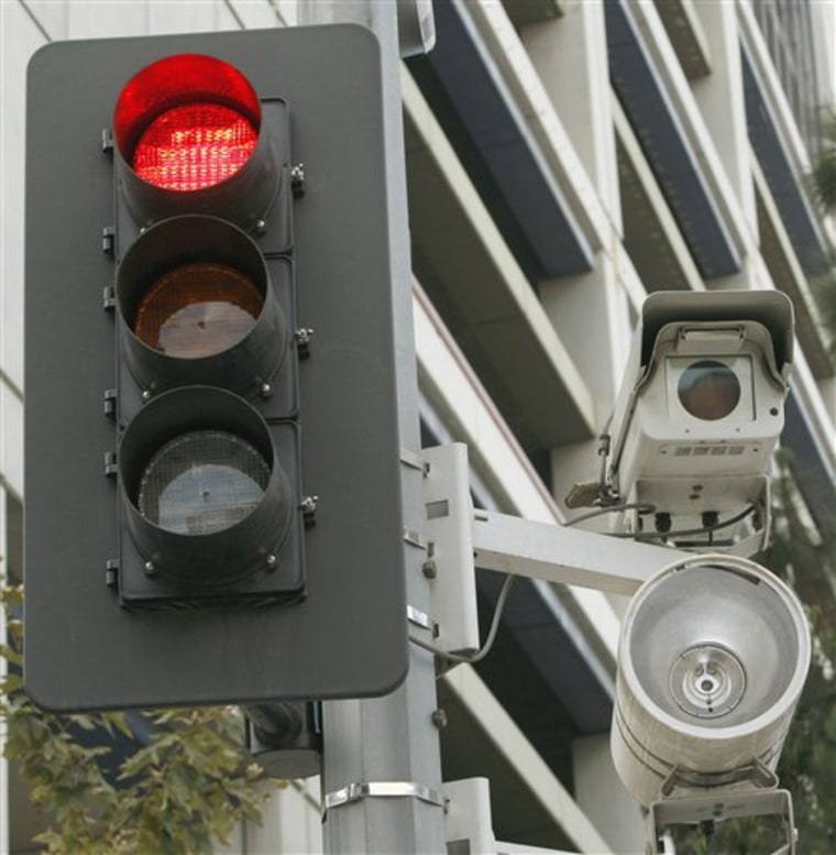 A red light camera set up in Los Angeles. One out of every five American lives in a community that outsources its enforcement of traffic violations caught by red light cameras to private vendors, according to a report by a consumer advocacy group. In many cases, those vendors a direct financial incentive to issue more tickets and to try to block alternative means of traffic enforcement.