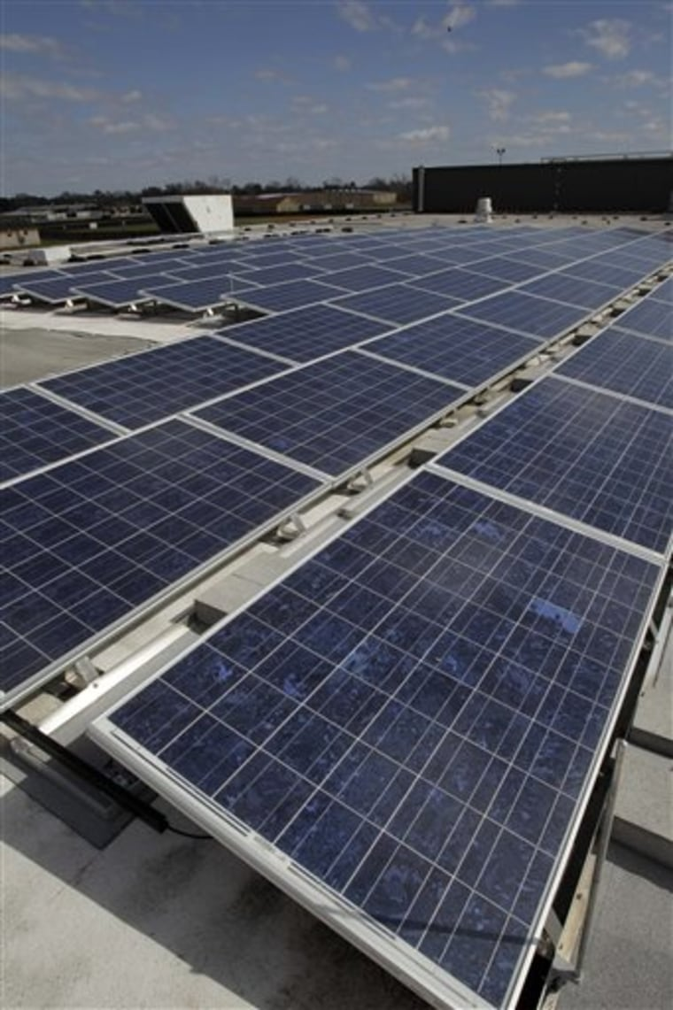New solar panels are seen on the roof of Sam Rayburn High School  Tuesday, Feb. 15, 2011, in Pasadena, Texas. The panels at Sam Rayburn and another area high schools are expected to save the school district $15,000 annually. (AP Photo/Pat Sullivan)