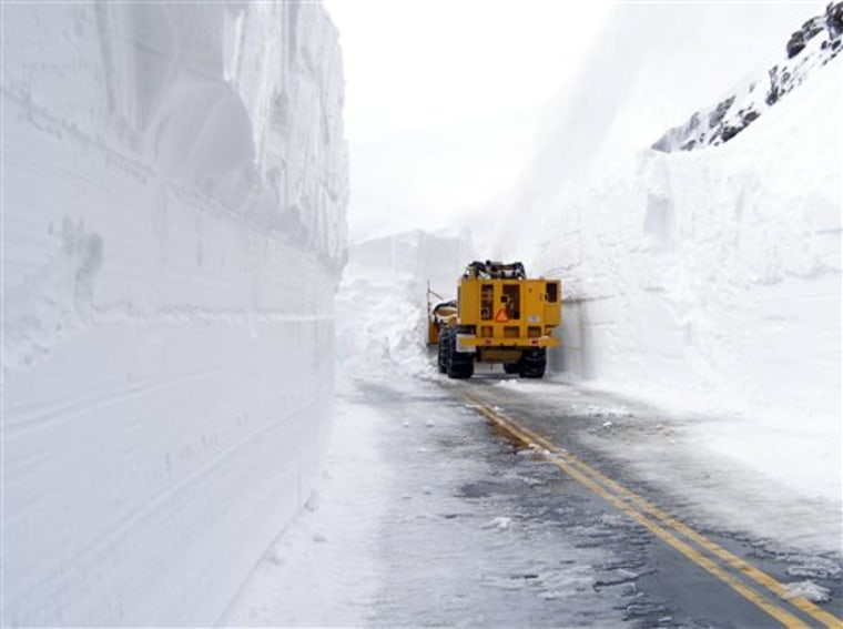 A snowplow faces 23 feet of snow on Trail Ridge Road in Rocky Mountain National Park in Colorado on May 13.