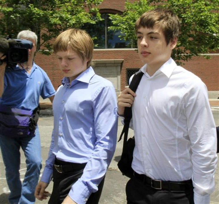 Tim Foley, 20, left, and his brother Alex, 16, leave federal court after a bail hearing for their parents, Donald Heathfield and Tracey Lee Ann Foley, in Boston, on Thursday.
