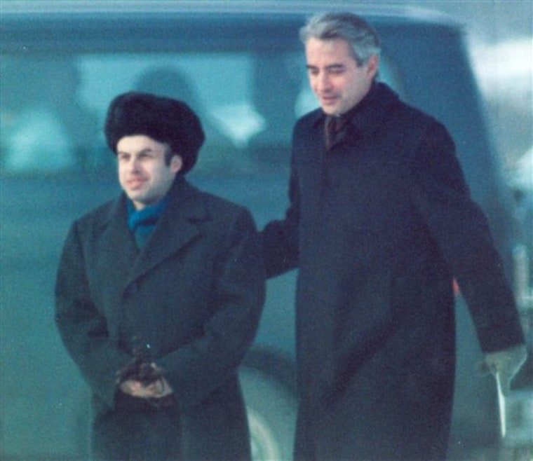 Soviet Jewish dissident Anatoly B. Shcharansky, left, is escorted by U.S. Ambassador Richard Burt after Shcharansky crossed the border between East Germany and West Berlin at Glienicke Bridge during an East-West spy and prisoner exchange on Feb. 11, 1986.