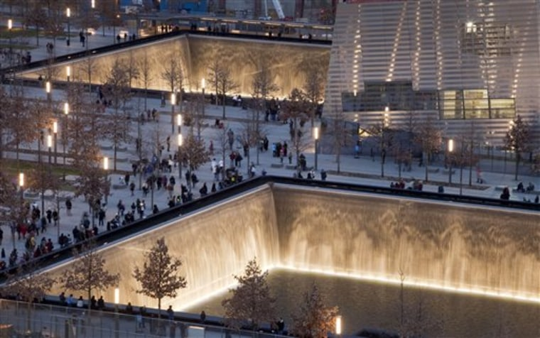 Visitors to the National September 11 Memorial in New York walk around its twin pools.