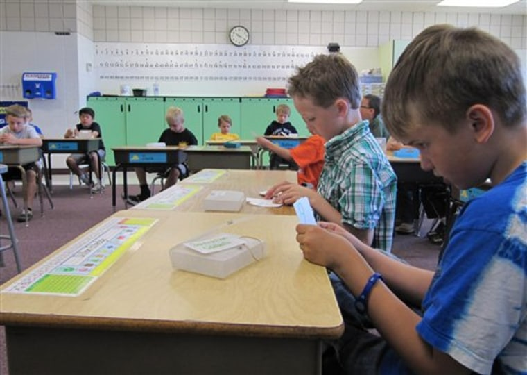 In this photo taken May 9, Dillon Elledge, 8, right, and Brody Kemble, 7, second from right, work with flash cards in their all-boys classroom at Middleton Heights Elementary in Middleton, Idaho. Middleton is believed to be the only public school in Idaho offering all-boy and all-girl classrooms, though the movement is widespread in other states.