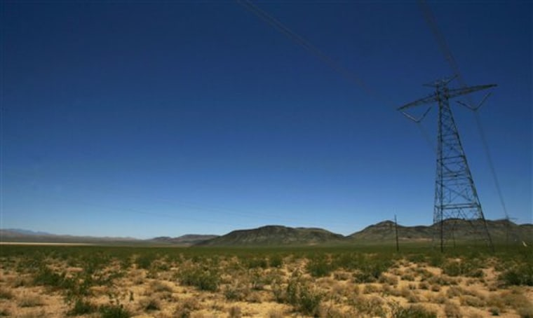 An electric tower and power lines cross the proposed site of a BrightSource Energy solar plant on federal land near Primm, Nev. The presence of existing towers make the area a prime site for solar development.