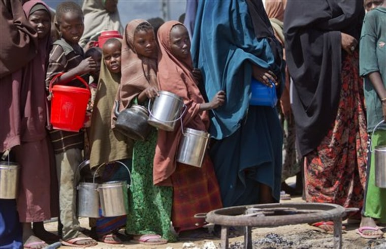 Children line up to receive a meal at a food distribution center for those displaced by last year's famine or by conflict, in Mogadishu, Somalia.