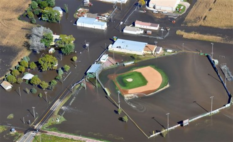 The Big Sioux River flooded this baseball field in Renner, S.D., on Sunday. Dozens of homes along the river were also flooded.