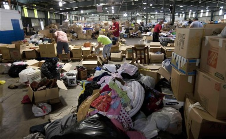 Volunteers sort through donated clothing at a warehouse in Tuscaloosa, Ala.