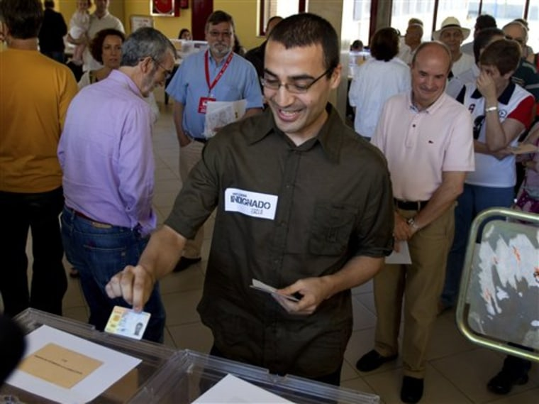 A man votes at a polling station in Madrid on Sunday. The ruling Socialist Party is bracing itself for stinging losses as voting begins amid protests in regional and municipal elections throughout Spain. The elections are a key test of how the party's support has crumbled due to soaring unemployment and its handling of the financial crisis, a prelude to general elections next year.