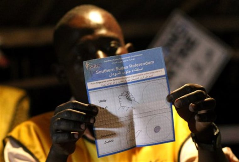 An election official shows a pro independence ballot as votes are tallied at polling station in Juba, South Sudan, on Saturday. Results began trickling in immediately after polls closed Saturday evening. Almost everyone expects the south to vote overwhelmingly to break away from the north, cleaving one of Africa's larger nations in two.