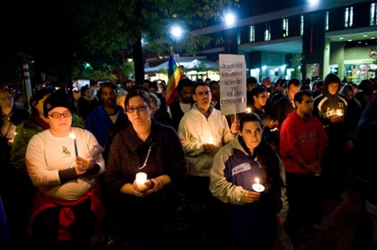 People participate in a candlelight vigil for Rutgers University freshman Tyler Clementi at Brower Commons on the Rutgers campus in New Brunswick, N.J., on Sunday.