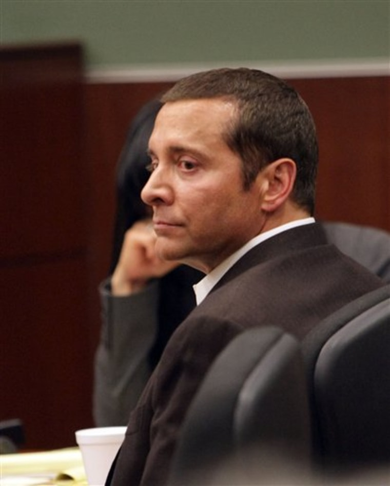 James Arthur Ray listens to testimony during his trial in Campe Verde, Ariz. Ray pleaded not guilty to three counts of manslaughter. Three people died following a sweat lodge ceremony he led near Sedona in October 2009.