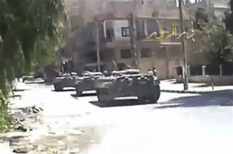 Syrian troops seized control of the eastern flashpoint city of Deir el-Zour on Wednesday following intense shelling and gunfire, an activist said.
