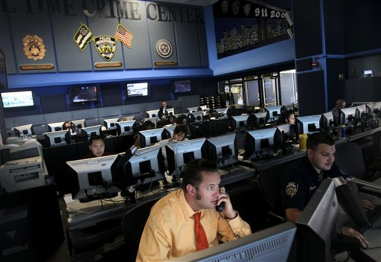 Employees work inside the Real Time Crime Center, Thursday, July 22, 2010, at police headquarters in New York.