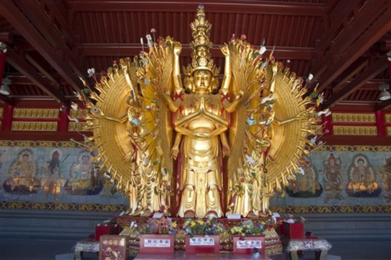 This photo released by Tourism British Columbia shows a golden Buddha statue at the International Buddhist Temple in Richmond, British Columbia.