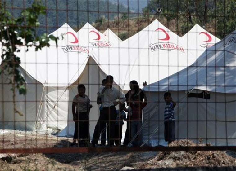 Syrians take refuge Thursday in a camp set up by the Turkish Red Crescent in Turkish town of Yayladagi in Hatay province, Turkey.
