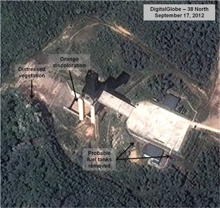 This Sept. 17, 2012 satellite image above, provided by DigitalGlobe and annotated by 38 North, shows a facility in Sohae, North Korea where analysts believe rocket engines have been tested in a sign North Korea continues to develop its long-range ballistic missiles. Below is another image from April 9.