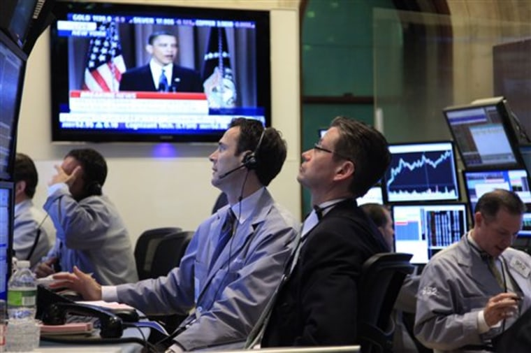 Traders work at the New York Stock Exchange during President Obama's speech Thursday.