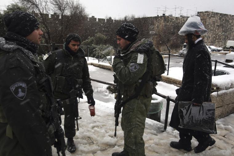 Snow falls in Jerusalem