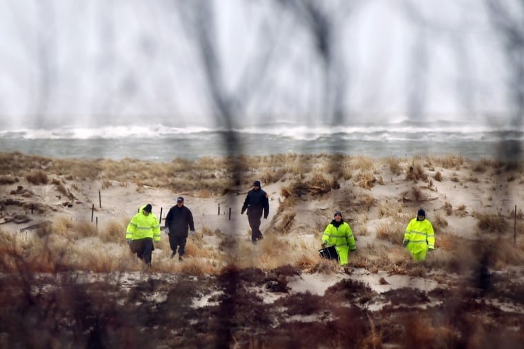Image: Police Investigators Search Long Island Beach Area After An Additional Bodies Were Found