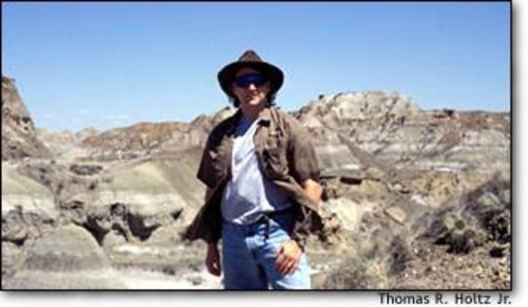 """University of Maryland paleontologist Thomas R. Holtz Jr. looks over the fossil-rich strata at Dinosaur Provincial Park in Alberta. Holtz served as a consultant on """"Walking With Dinosaurs"""" and """"When Dinosaurs Roamed America,"""" and wrote a """"Jurassic Park"""" dinosaur guide."""