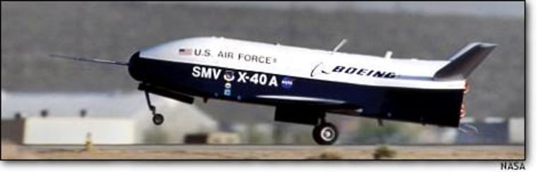 The X-40A experimental plane lands at Edwards Air Force Base in California after a flight test in May. NASA and the Boeing Co. are working on the project for civilian applications, but the Air Force is interested in adapting the X-40A and its planned full-scale successor, the X-37, for military use.