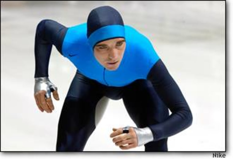Dutch speed skater Bob de Jong assumes the start position in a Nike Swift Skin suit. The half-gloves are made of a slippery material that reduces drag. The light-colored fabric at the inner thigh contains microscopic glass beads to reduce friction between moving parts.