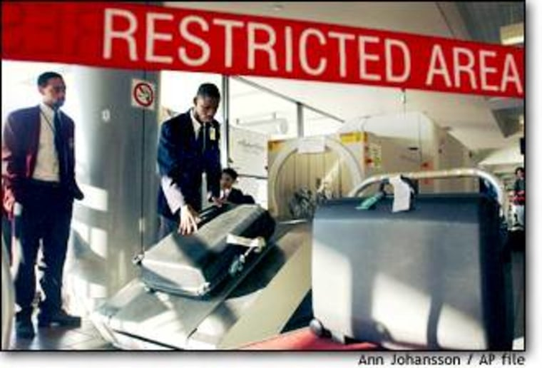 Security agents screen luggage at Los Angeles International Airport.