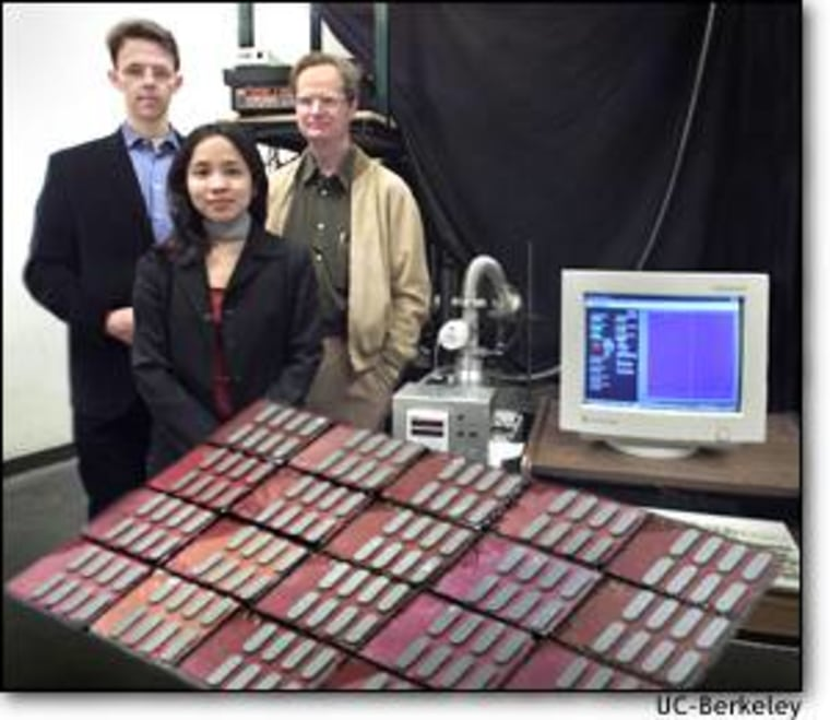 Janke Dittmer, Wendy Huynh and Paul Alivisatos of the University of California at Berkeley show off an experimental array of solar cells. An electrical current is generated within a brownish-orangish film of plastic.