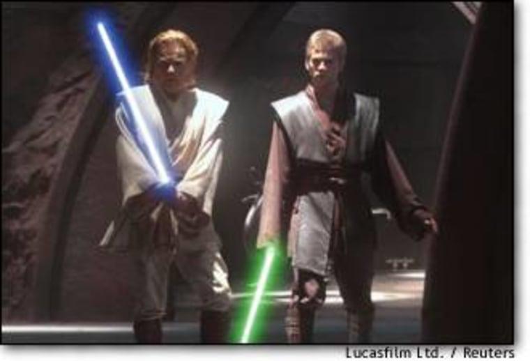 """Obi-Wan Kenobi (Ewan McGregor, at left) and his Jedi apprentice, Anakin Skywalker (Hayden Christensen), wield lightsabers in """"Star Wars, Episode II: Attack of the Clones."""""""