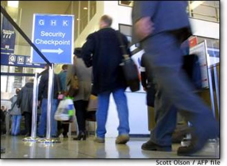 Passengers wait in line to pass through an American Airlines security checkpoint at Chicago's O'Hare International Airport, where aviation officials conducted the secret test.