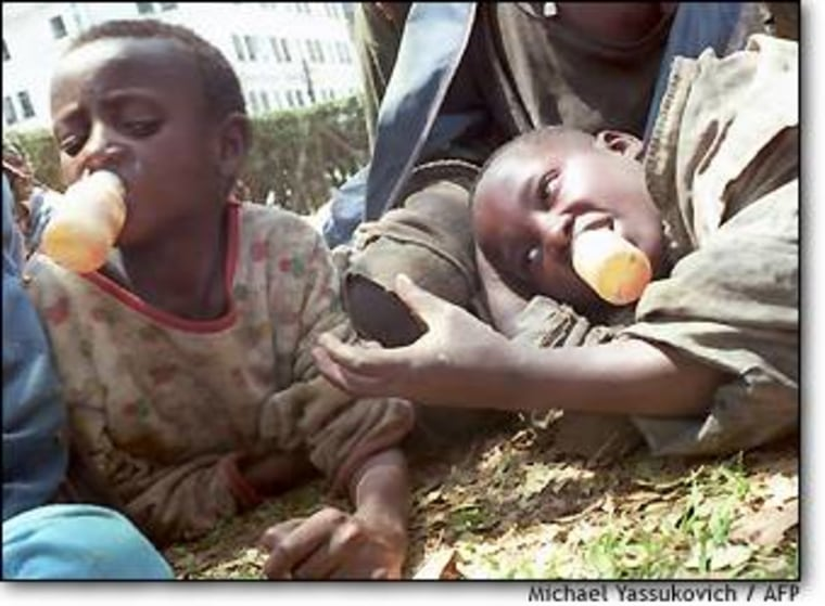 Street children sniff glue in Nairobi.