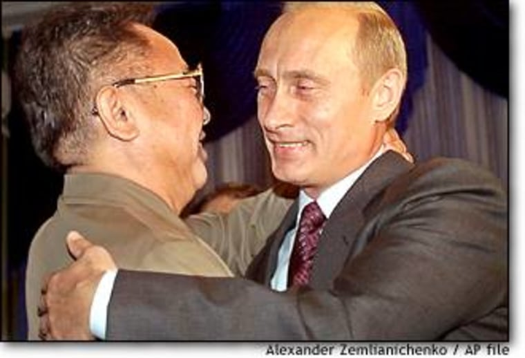 Russian President Vladimir Putin, right, smiles as he greets North Korean leader Kim Jong Il during their meeting in Vladivostok last month.