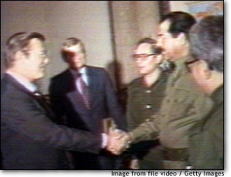 Donald Rumsfeld, shown in December 1983 shaking hands with Iraqi President Saddam Hussein in Baghdad, was then an aide to President Reagan.