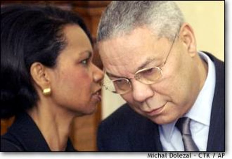 National Security Adviser Condoleezza Rice talks to Secretary of State Colin Powell in Prague on Thursday. Rice says that the White House is deeply skeptical of Saddam's intentions.
