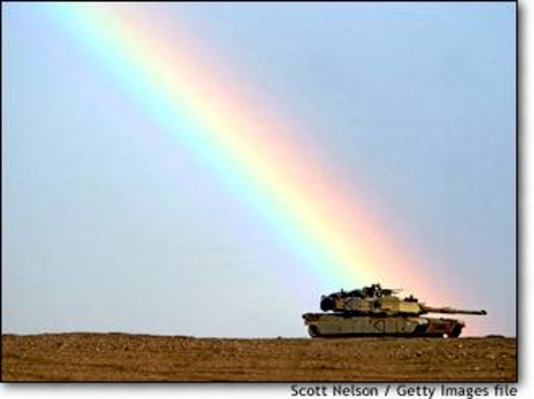 A rainbow breaks over an American M1/A1 Abrams tank during exercises last month near the Iraqi border in Kuwait. The realities of war are seldom this pretty.