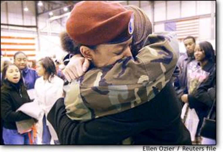 North Carolina Army National Guard Private 1st Class Brooklyn Dorsey, left, gets farewell hug from friend and sorority sister Nikki Nowlin, in Morrisville, N.C. last week.