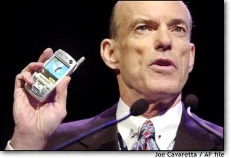 Sprint Corp. Chairman and CEO Bill Esrey holds a Sanyo phone at last year's Consumer Electronics Show in Las Vegas. Sprint ousted Esrey and another top executive after the IRS questioned their efforts to shelter stock options from taxes.