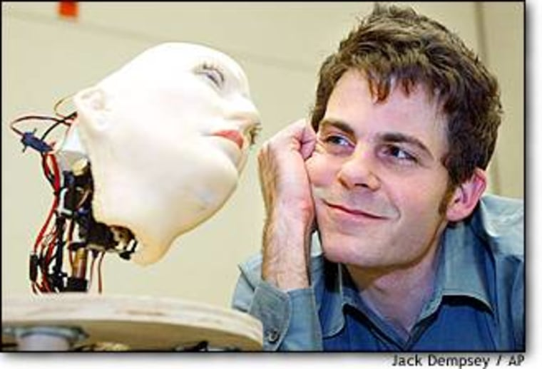 """Researcher David Hanson gazes at K-Bot, the expressive robo-face he created from $400 worth of parts and a material he calls """"F'ubber."""""""