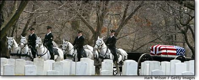 Horse-drawn caissons carry the casket of astronaut Lt. Col. Michael P. Anderson during a full honor funeral service Friday at Arlington National Cemetery in Virginia.