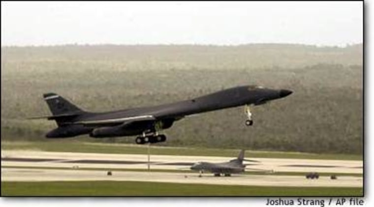 A B1-B Lancer takes off past another B1-B during a touch and go at Andersen Air Force Base, Guam, on March 14.