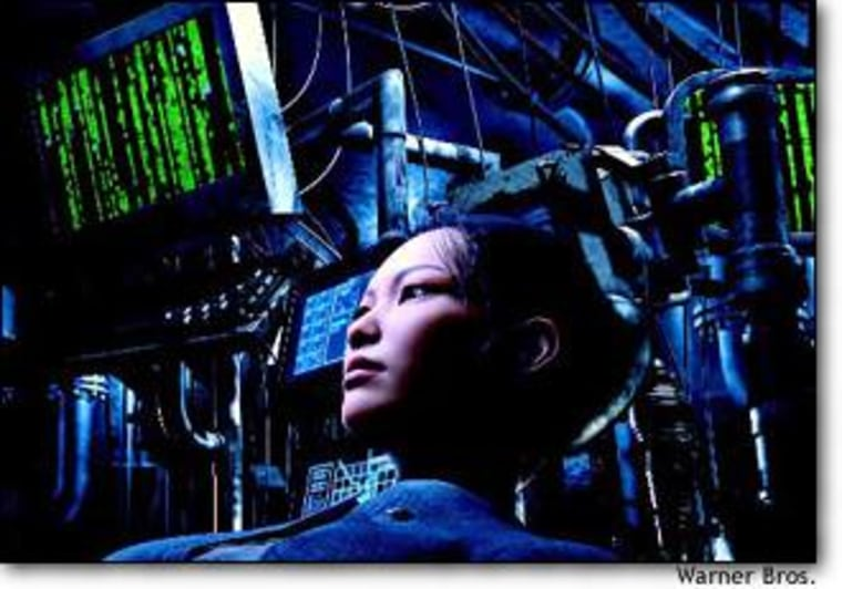 """Jue, the first mate of the Osiris, is surrounded by """"Matrix"""" monitors in a scene from """"The Final Flight of the Osiris,"""" a computer-generated featurette premiering in theaters Friday."""