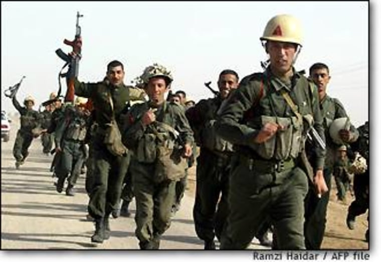 Iraqi Republican Guard troops run during endurance training earlier this month southeast of Baghdad.