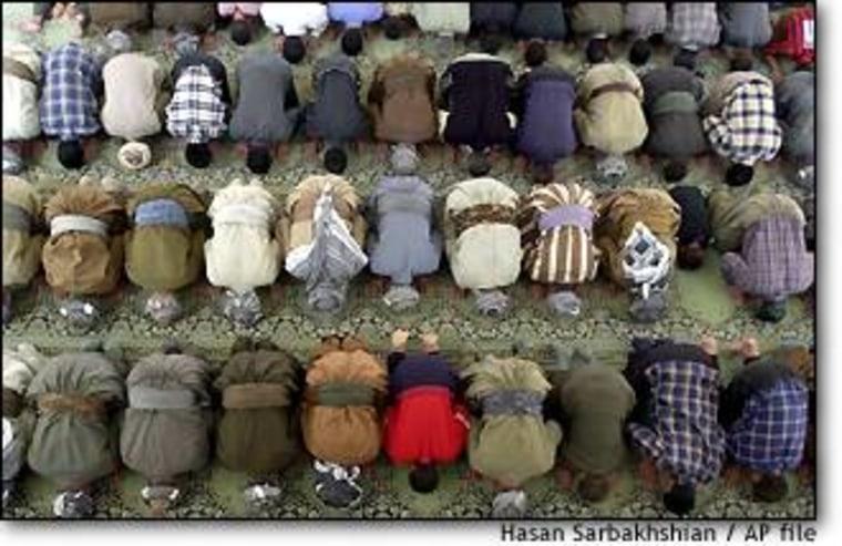 Iraqi Kurdish Sunni Muslims kneel during Friday prayers last autumn at the Salaheddin Mosque in Dahuk, northern Iraq.