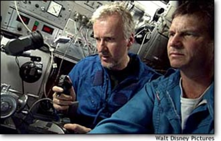 """James Cameron, producer and director of """"Ghosts of the Abyss,"""" shares a submersible with narrator Bill Paxton, at right, during a filming expedition to the wreckage of the Titanic in 2001."""