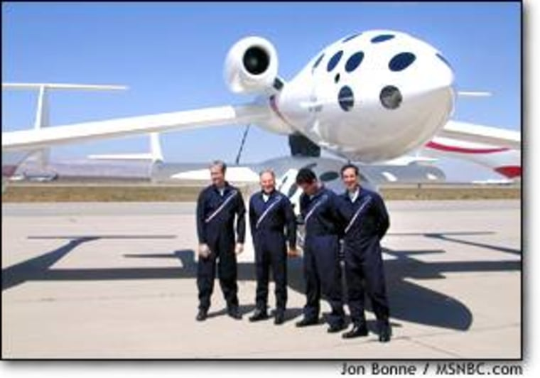 White Knight and SpaceShipOne sit on the Mojave tarmac Friday. In front, from left, are the project's pilots: Doug Shane, Mike Melvill, Peter Siebold and Brian Binnie.