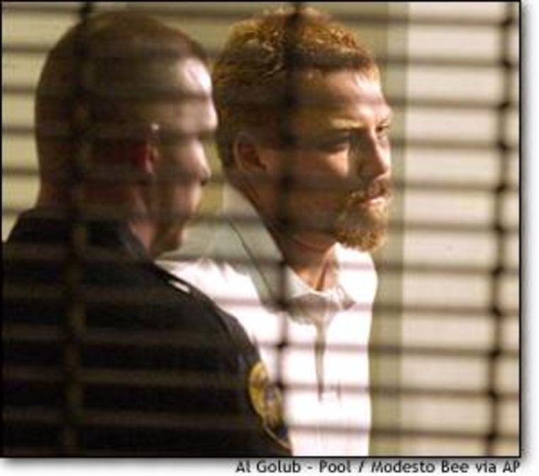 Scott Peterson was escorted into the county jail in Modesto, Calif., in April.