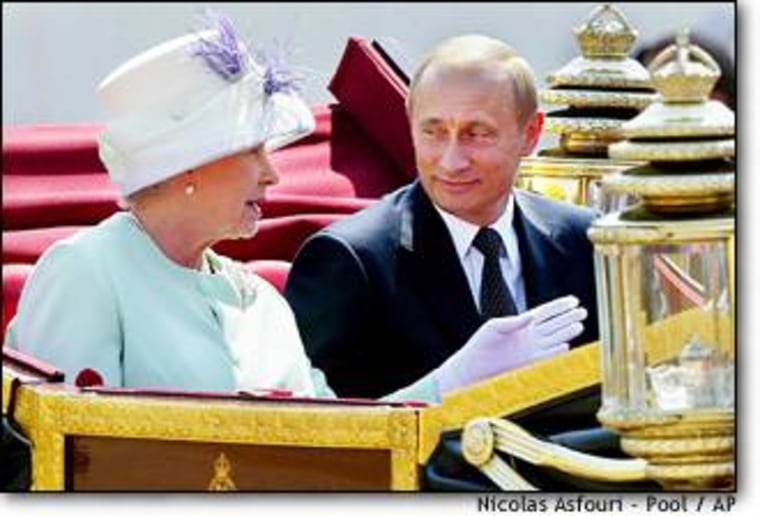 President Vladimir Putin, right, and Britain's Queen Elizabeth II, leave in an open carriage after Russian leader was given a ceremonial welcome on Horse Guards Parade in London on Tuesday.